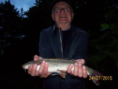 Bingley AC life member Kevin Sunderland with a River Aire Barbel.