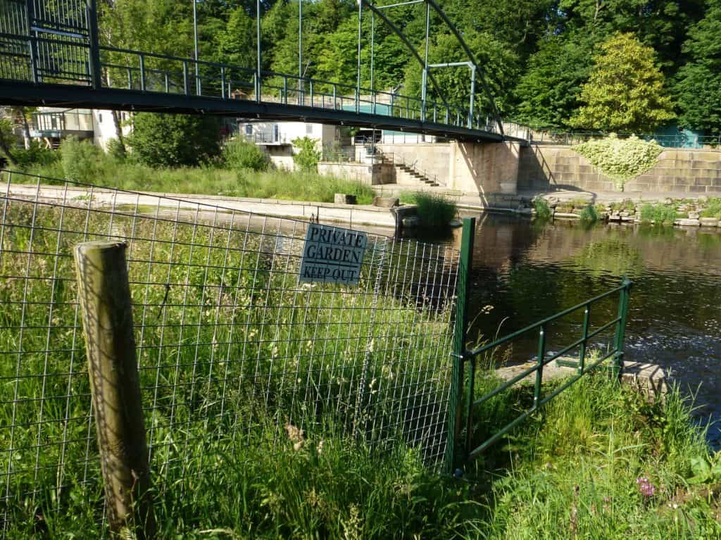 This fence marks the upper fishing limit of the Bingley Angling Club stretch of the River Wharfe at Wray Wood, Boston Spa